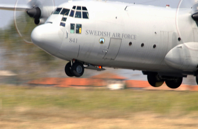 A Swedish Air Force C-130 Hercules aircraft lands at Graf Ignatievo Air Base, Bulgaria, during Exercise COOPERATIVE KEY 2003. The Exercise is designed to promote dialogue between North Atlantic Treaty Organization (NATO) partner nations, while conducting peace support operations