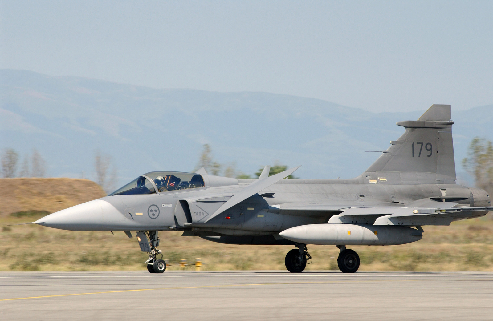 A Swedish Air Force JAS-39 Gripen fighter aircraft arrives in support of the Partnership for Peace Exercise Cooperative Key 2003 at Graf Ignatievo Air Base (AB), Bulgaria (BGR) - U.S. National Archives