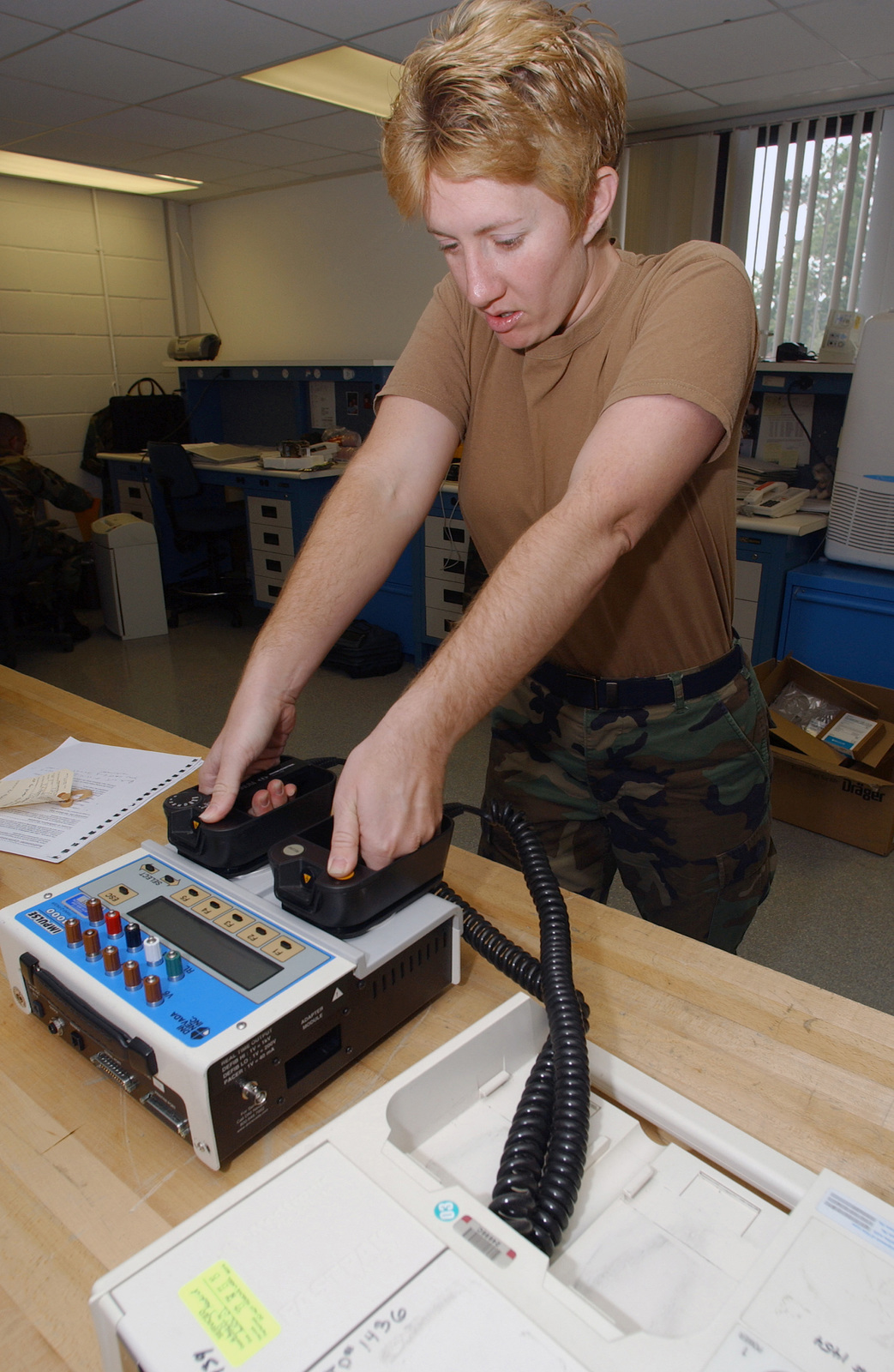 US Air Force (USAF) AIRMAN First Class (A1C) Jana Madrid, with the 48th Medical Support Squadron (MSS), Royal Air Force (RAF) Lakenheath, England (ENG), a biomedical technician, does preventative maintenance on a Medtronic Physio Control defibrillator