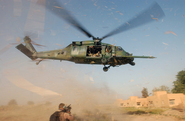 A US Air Force (USAF) 101st Expeditionary Rescue Squadron (ERS) HH-60G Pave Hawk helicopter kicks up dust while departing a landing zone during a Combat Search And Rescue (CSAR) exercise. The exercise sharpens the skills of CSAR teams deployed to Baghdad International Airport (BIA), Iraq, during Operation IRAQI FREEDOM