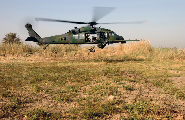 A US Air Force (USAF) 101st Expeditionary Rescue Squadron (ERS) Pararescueman fast- ropes to the ground from an HH-60G Pave Hawk helicopter during a Combat Search and Rescue (CSAR) exercise at Baghdad International Airport (BIA), Iraq (IRQ), in support of Operation IRAQI FREEDOM