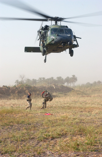 US Air Force (USAF) Pararescuemen from the 101st Expeditionary Rescue Squadron (ERS), practice being lowered from an HH-60G Pave Hawk helicopter during a Combat Search And Rescue (CSAR) exercise. The exercise sharpens the skills of CSAR teams deployed to Baghdad International Airport (BIA), Iraq, during Operation IRAQI FREEDOM