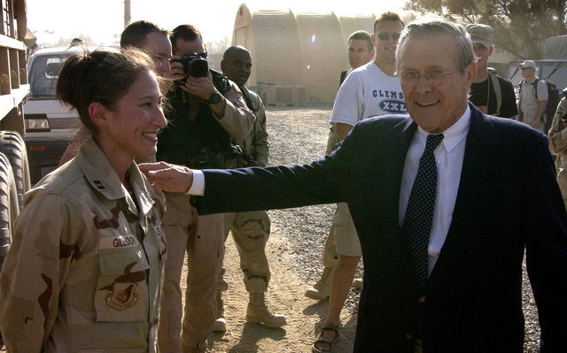 US Secretary of Defense (SECDEF) Donald H. Rumsfeld greets US Air Force (USAF) Captain (CAPT) Miki Gilloon, from the 447th Air Expeditionary Group (AEG) Public Affairs (PA) office, at Baghdad International Airport (BIA), Iraq (IRQ), during Operation IRAQI FREEDOM