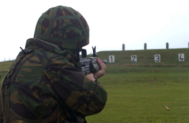 British Territorial Army (BTA), Private (PVT) Robert Hardingham, with the 166th Regiment, practices target shooting with an L85 Individual Weapon (IW) during a multinational exercise on the island of Benbecula, off the coast of Scotland (SCT)