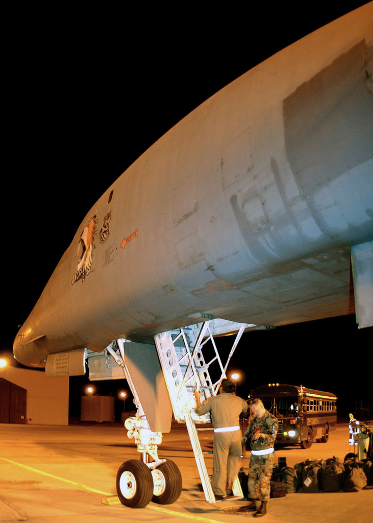 US Air Force (USAF) personnel from the 37th Bomb Squadron (BS), 28th Bomb Wing (BW), Ellsworth Air Force Base (AFB), South Dakota (SD), load baggage onto a B-1B Lancer bomber in preparation for a real world deployment