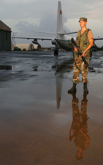 US Air Force (USAF) AIRMAN First Class (A1C) Aaron Downing, deployed from the 100th Security Forces Squadron (SFS), Royal Air Force (RAF) Mildenhall, England (ENG), stands guard after a rainstorm at Dakar International Airport (BIA), Senegal. Downing is deployed to the 398th Air Expeditionary Group (AEG), in support of peacekeeping efforts in Liberia