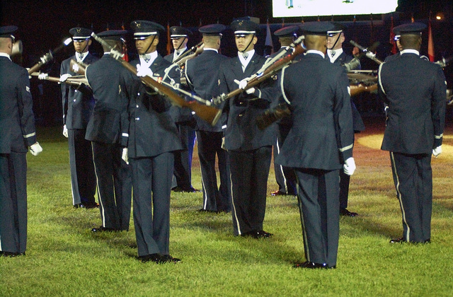 "US Air Force (USAF) personnel with the Air Force Honor Guard Drill Team perform one of their signature moves ""The Double Spins,"" during the Air Force Tattoo full dress rehearsal, at Bolling Air Force Base (AFB), in District of Columbia (DC)"