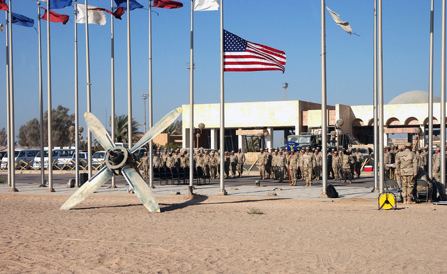 At Baghdad International Airport (BIA), Iraq, the men and women of the US Air Force (USAF) 447th Air Expeditionary Group (AEG), assemble for retreat and a Remembrance Ceremony honoring the victims of the terrorist attacks of September 11th, 2001, during Operation IRAQI FREEDOM