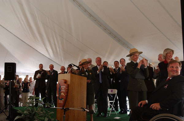 Members of the Flight 93 National Memorial Federal Advisory Commission, on hand for the Commission swearing-in ceremony at the site of the temporary memorial, near Shanksville, Pennsylvania, honoring the passengers and crew of the plane hijacked during the terrorist attacks of September 11, 2001