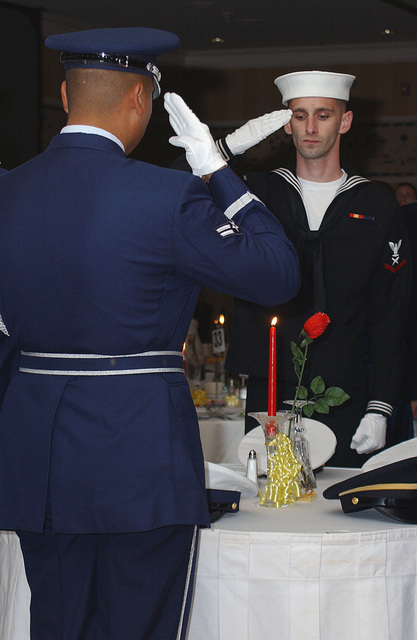 US Air Force (USAF) AIRMAN First Class (A1C) Gabriel Marquez, Elmendorf Air Force Base (AFB) Honor Guard, and US Navy (USN) PETTY Officer Third Class (PO3) Keith Elinkowski present arms during the POW/MIA Table Ceremony at the Air Force Ball held at the Anchorage Sheraton Hotel in Anchorage, Alaska (AK)