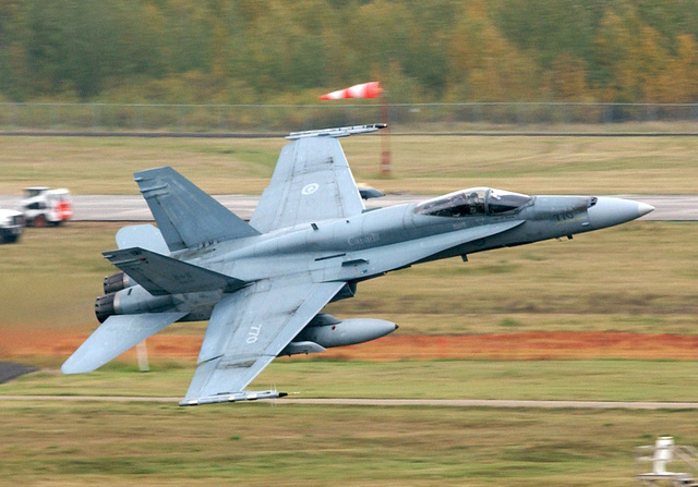 "A Royal Canadian Air Force (RCAF) CF-18 Hornet, 4-Wing, takes off from Cold Lake, Alberta, Canada during the second Tiger Meet of the Americas. The Hornet is carrying two types of Air Combat Maneuvering Instrumentation (ACMI) pods on the wing tips. The Tiger Meet of the Americas, first ever held in Canada, inaugurated in 2001 in the Western Hemisphe to carry on the Tiger tradition of the long-established European original experience; promoting solidarity and operational understanding between NATO members. The Meet attracted 400 participants and over 20 aircraft, with at least 6 fighter jets painted in distinctive ""Tiger"" schemes. For a squadron to be invited, only one simple criterion..."