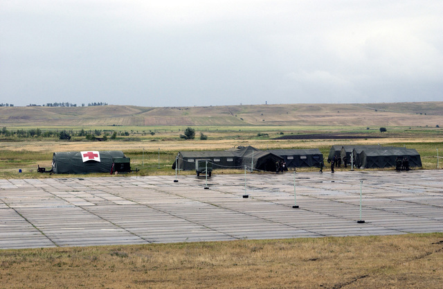 Emergency medical tents are set up at Vaziani Air Base (AB), country of Georgia, in preparation for a mass casualty exercise. The scenario involves 60 earthquake victims with injuries ranging from broken limbs to chemical exposure. The mass casualty exercise is the culmination of RESCUER/MEDCEUR 03, a two-week multinational exercise enabling US personnel to train for contingency medical emergencies and has the added benefit of training the Georgian Army on advanced medical techniques. RESCUER/MEDCEUR 03 is sponsored by the United States and hosted by the country of Georgia