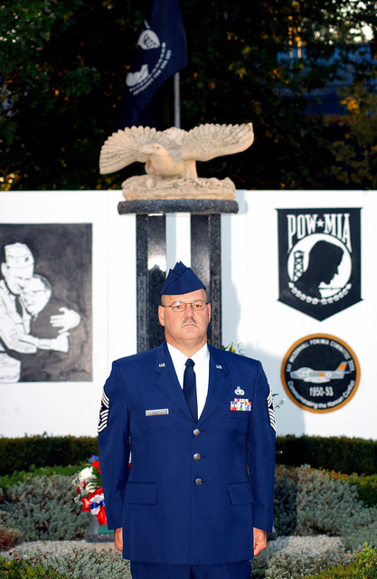 US Air Force (USAF) Command CHIEF MASTER Sergeant (CCM) William Scott, 100th Air Refueling Wing (ARW), Royal Air Force (RAF) Mildenhall, United Kingdom, stands at attention as the names of missing service members from the Korean Conflict are read as a tribute for POW/MIA Day. Roughly, 130 volunteers read the names in five-minute increments from reveille to retreat