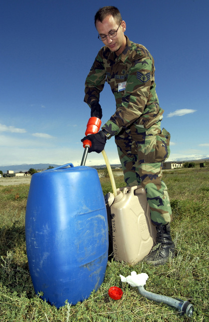 US Air Force (USAF) STAFF Sergeant (SSGT) Michael Overton, 86th Medical Group (MDG), Ramstein Air Base (AB), Germany, fills a gas can to restart the generator that powers his units crisis response tent during a mass casualty exercise at Vaziani AB, country of Georgia. The mass casualty exercise is the culmination of RESCUER/MEDCEUR 03, a two-week multinational exercise enabling US personnel to train for contingency medical emergencies and has the added benefit of training the Georgian Army on advanced medical techniques. RESCUER/MEDCEUR 03 is sponsored by the United States and hosted by the country of Georgia