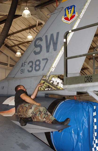 US Air Force (USAF) STAFF Sergeant (SSGT) Richard L. Pumphrey, Aircraft Crew CHIEF, 20th Aircraft Maintenance Squadron (AMXS), Shaw Air Force Base (AFB), South Carolina (SC), works on the tail assembly of a 20th Fighter Wing (FW) USAF F-16 Fighting Falcon