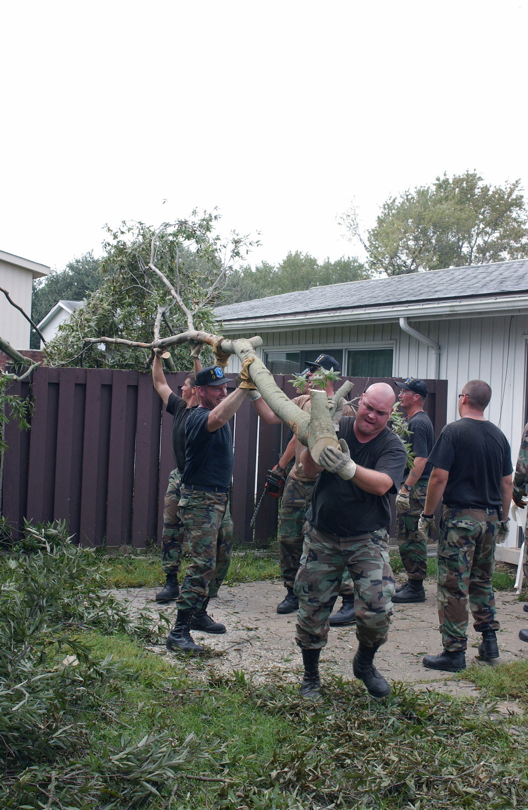 US Air Force (USAF) cleanup crews from the 1ST Civil Engineering Squadron (CES) in conjunction with other units work throughout Langley Air Force Base (AFB), Virginia (VA), cleaning up trees and debris left behind by Hurricane Isabel