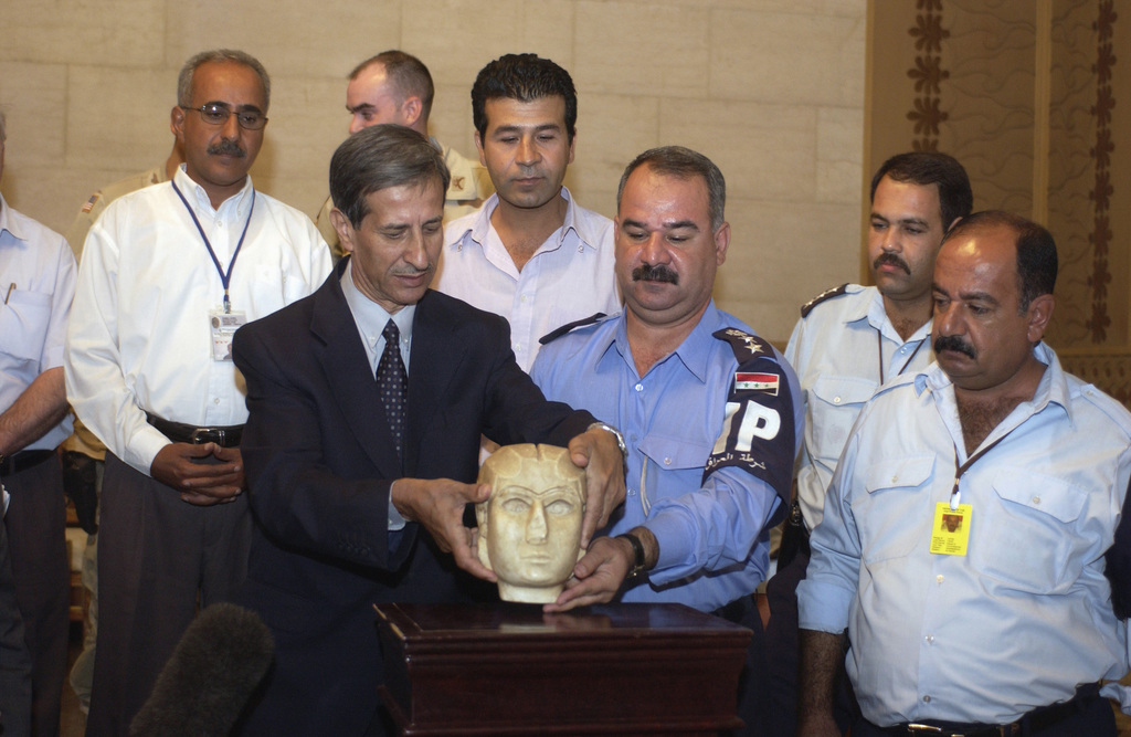 Dr. Jabir Khalil Ibrahim (left), State Board of Antiquities and Colonel (COL) Safa Adeen Mahdi Salih, Iraqi Police, hold the Warka Mask a marble sculpture dating from circa 3100 BC. The Warka Mask was missing from the Iraqi Museum since the liberation of Iraq. The Al Qanot Police station of the Iraqi Police service and the 812th Military Police Company (MP CO), 519th Military Police Battalion (MP BN), 18th Military Police Brigade (MP BDE), in a joint investigation recovered the Warka Mask during Operation IRAQI FREEDOM