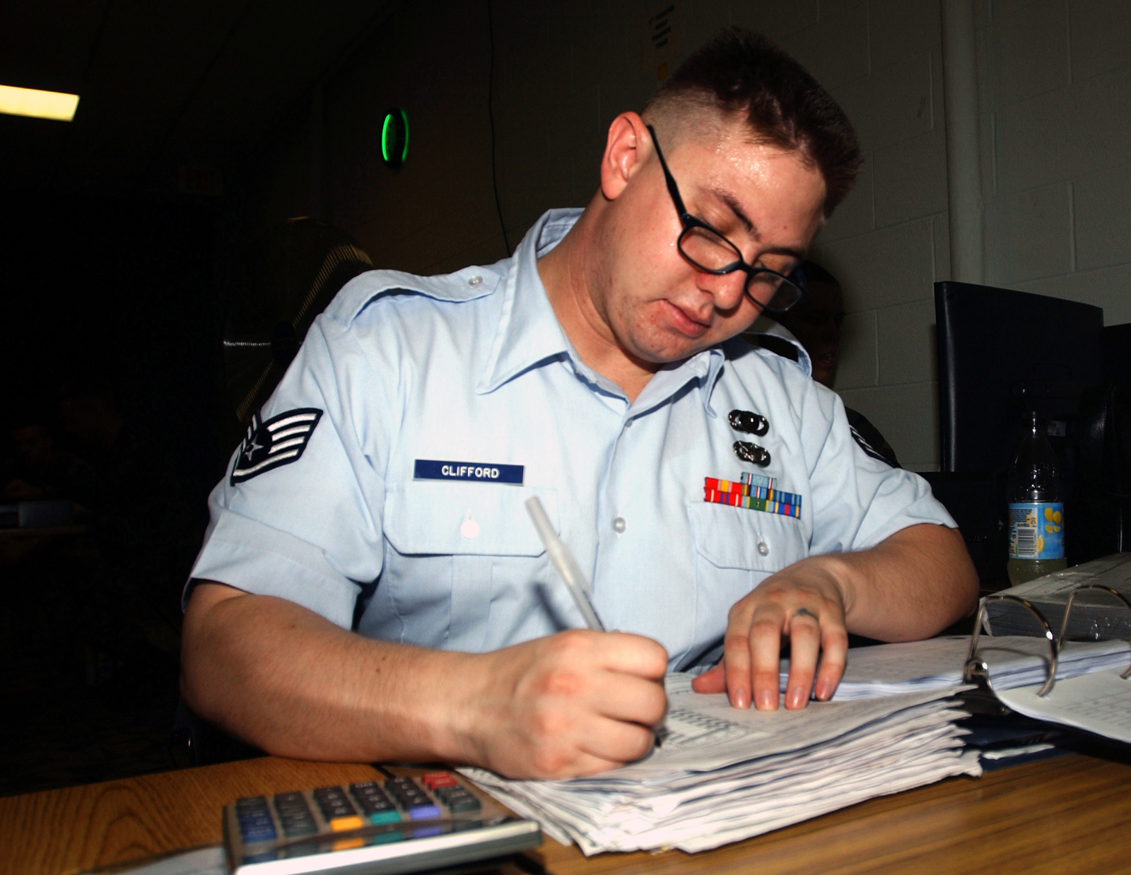 US Air Force (USAF) STAFF Sergeant (SSGT) Joshua Clifford, 99th Comptroller Squadron (CPTS), Nellis Air Force Base (AFB), Nevada (NV), TDY (Temporary Duty) to Langley AFB with the 1ST CPTS lends a helping hand handling the many claims and travel vouchers coming through their offices due to the evacuation because of Hurricane Isabel