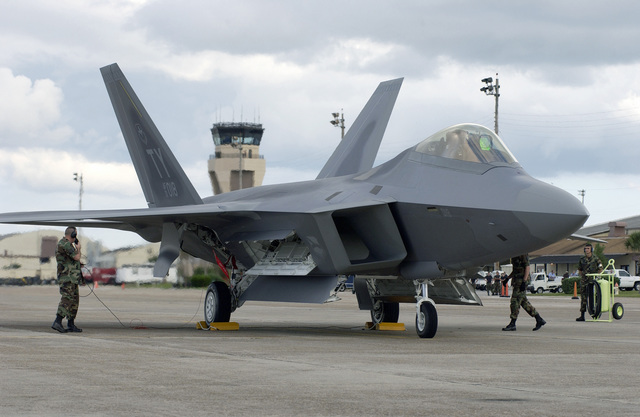 Raptor (number 18), the first F/A-22 delivered to the US Air Force (USAF), sits on the ramp after landing at Tyndall Air Force Base (AFB), Florida (FL), as the ground crew checks over the aircraft