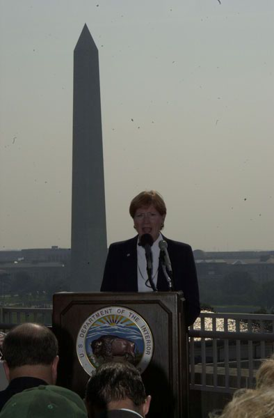 Take Pride in America Director Martha Allbright at the podium during award ceremonies, on the rooftop of the Department of Interior headquarters building, honoring individuals, youth groups, schools, organizations, partnerships, businesses involved in volunteer conservation efforts under the Take Pride inAmerica program