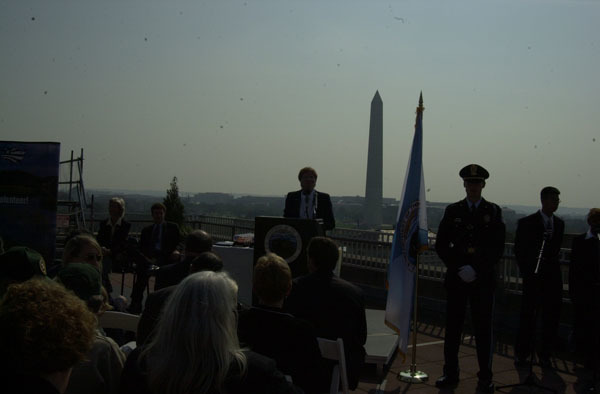 Take Pride in America Director Martha Allbright at the podium during award ceremonies, on the rooftop of the Department of Interior headquarters building, honoring individuals, youth groups, schools, organizations, partnerships, businesses involved in volunteer conservation efforts under Take Pride in America