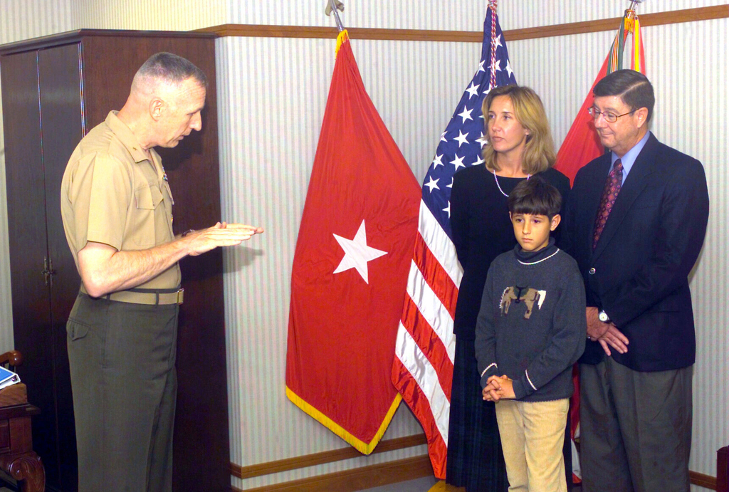 US Marine Corps (USMC) Brigadier General (BGEN) William Catto, (left) Commander, Marine Corps System Command, imparts words of wisdom to USMC Colonel (COL) Beranl Allen and family during his retirement ceremony held aboard Marine Corps Base (MCB) Quantico, Virginia (VA). COL Allen is retiring as the Director, Products Group, Marine Air Group Task Force