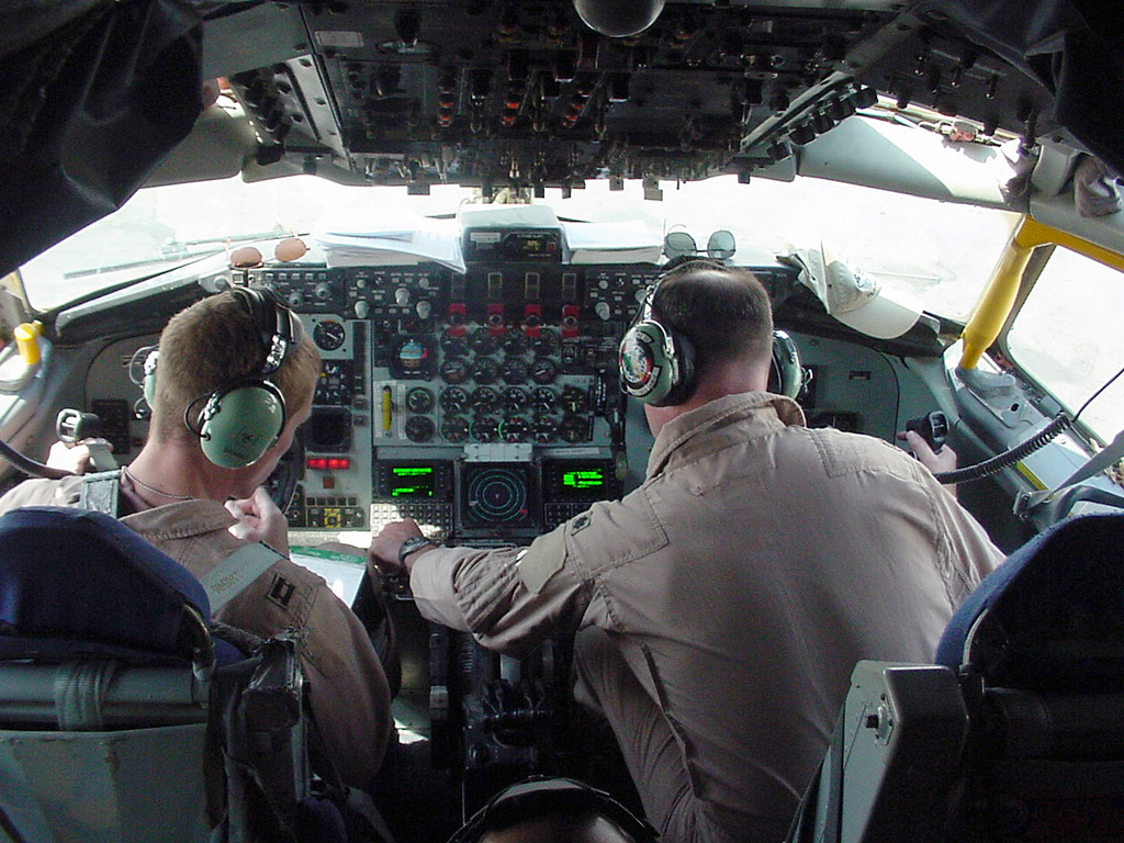 On the flightdeck of a US Air Force (USAF) KC-135R Stratotanker, USAF Captain (CPT) Devin Shanks (left), Pilot, 340th Expeditionary Air Refueling Squadron (EARS), and USAF Lieutenant Colonel (LTC) Seth Beaubien, Commander, 340th EARS, ready a tanker for an Operation IRAQI FREEDOM mission. Both deployed to this undisclosed base from the 92nd Air Refueling Wing (ARW), Fairchild Air Force Base (AFB), Washington (WA)