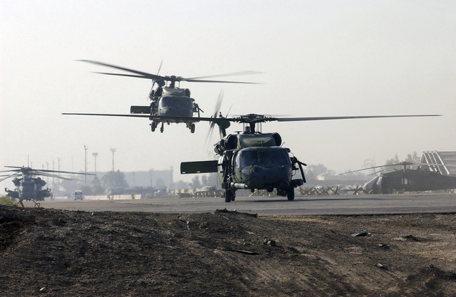 Two US Air Force (USAF) HH-60 Pave Hawk helicopters assigned to the 101st Expeditionary Rescue Squadron (ERS), take-off at Baghdad International Airport (BIA), Iraq (IRQ), in support of Operation IRAQI FREEDOM