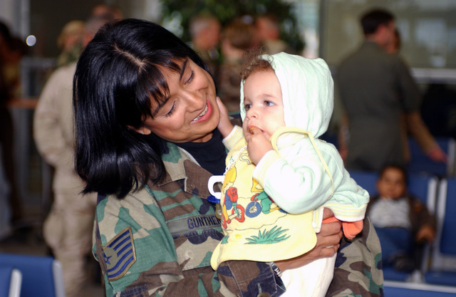 US Air Force (USAF) Technical Sergeant (TSGT) Maria Gunther of the 786th Communications Squadron (CS), says hello to one of the 18 Iraqi children flown in from Baghdad International Airport (BIA), for medical care from hospitals throughout Rheinland-Pfalz, DEU