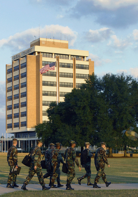 A group of US Army (USA) Soldiers walk pass, the Signal Towers Building, on their early morning march to their Advanced Individual Training (AIT), at Fort Gordon, Georgia (GA)