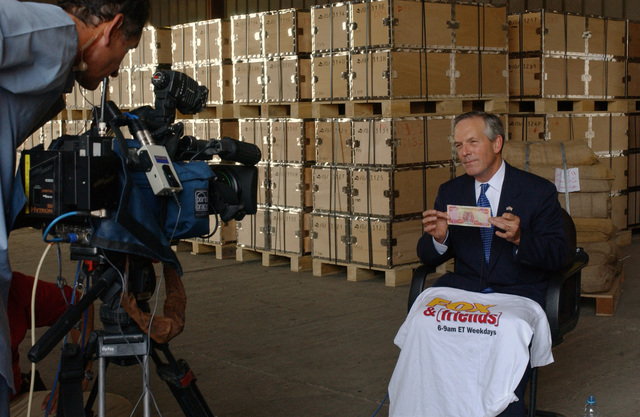 US Secretary of Commerce the honorable Don Evans discusses the new Iraqi Dinar during an interview with FOX media. The event was held in a Baghdad Airport (BIA) warehouse holding millions of new dinar currency