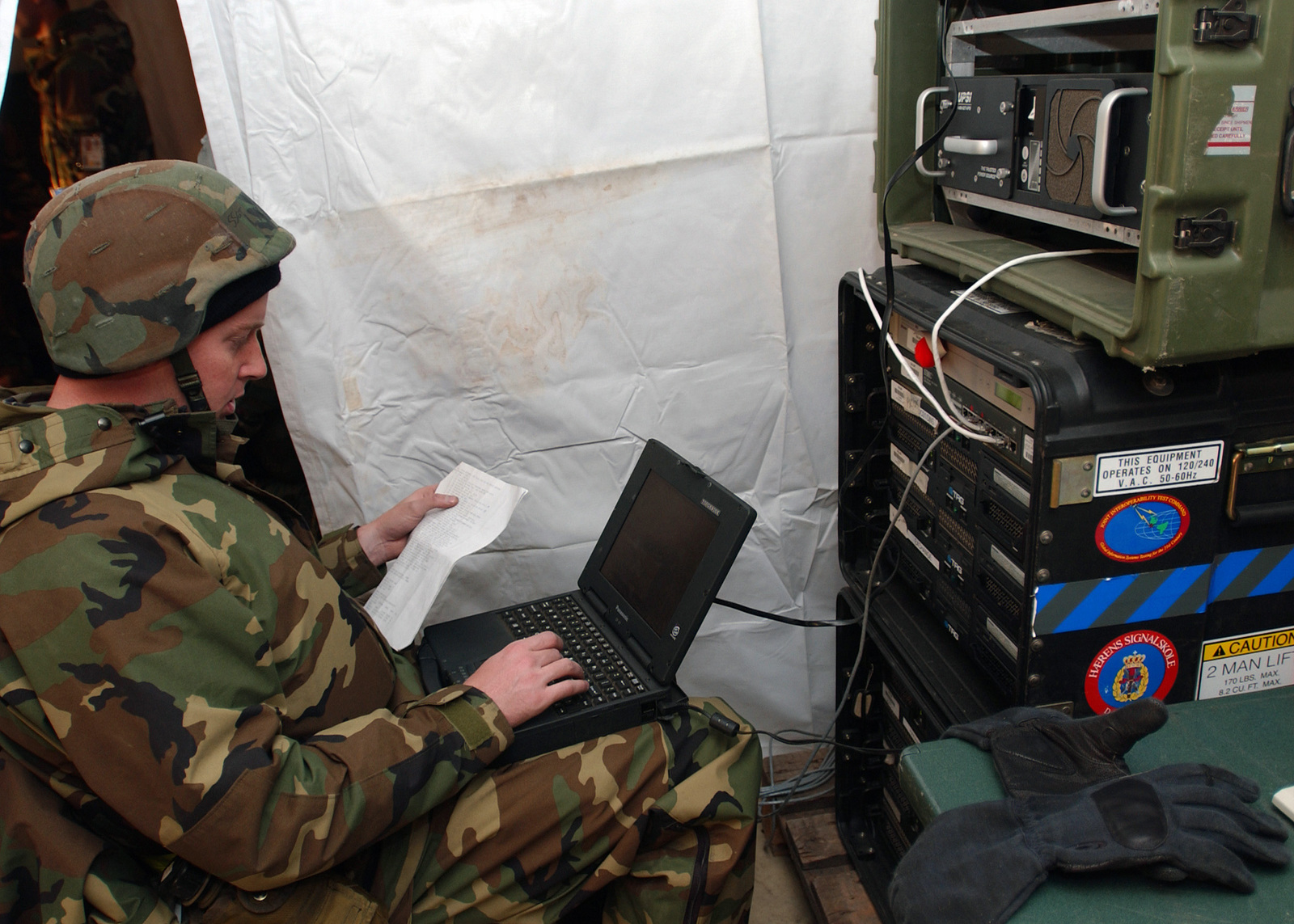 US Air Force (USAF) STAFF Sergeant (SSGT) Mark Lyons, a Communications Computer Systems Operator (CCSO), with the 31st Communications Squadron (CS), Aviano Air Base (AB), Italy (ITA), fixes a laptop during Exercise Silver Flag. The purpose of exercise Silver Flag is to equip a deployable communications team with the essential knowledge and skills to establish communications at a bare base site