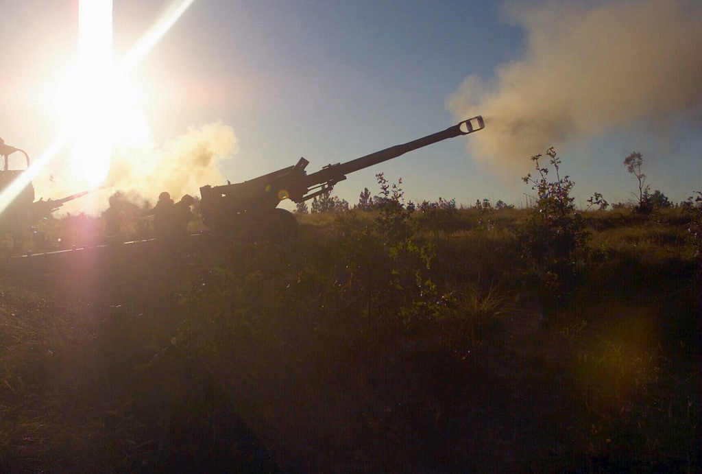 At Fort Bragg, North Carolina, US Marine Corps (USMC) personnel with the 10th Marines, 2nd Marine Division, fire a 96 pound 155mm artillery round from an M198 Towed Howitzer, during Exercise ROLLING THUNDER 2003