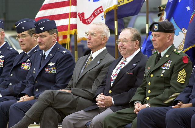 """Recipients of the Pennsylvania (PA) State Air National Guard (ANG) Hall of Fame Award, retired US Air Force (USAF) Major General (MGEN) Ace Hearon, left center and SENIOR MASTER Sergeant (SMSGT) Peter Volpe, also retired are flanked by USAF Colonel (COL) Stephen Sischo, Commander of the 111th Fighter Wing (FW), left and US Army (USA) Command Sergeant Major (CSM) Horace """"Chad"""" Pysher, of the Pennsylvania Army National Guard (ANG), right, during the ceremony at Willow Grove Air Reserve Station (ARS)"""