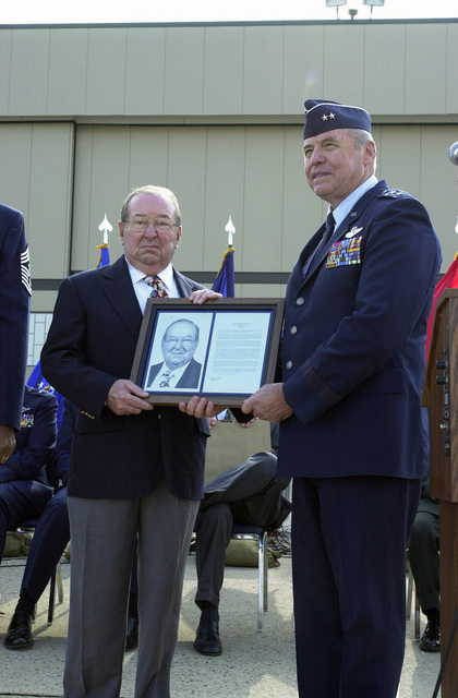 US Air Force (USAF) Major General (MGEN) James Skiff, Deputy Adjutant General (DAG) and Commander of the Pennsylvania Air National Guard (ANG) presents the State Air National Guard (ANG) Hall of Fame Award to retired USAF SENIOR MASTER Sergeant (SMSGT) Peter Volpe, in a ceremony at Willow Grove Air Reserve Station (ARS)