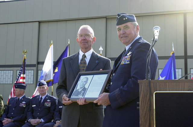 US Air Force (USAF) Major General (MGEN) James Skiff, right, Deputy Adjutant General (DAG) and Commander of the Pennsylvania Air National Guard (ANG) presents the State Air National Guard (ANG) Hall of Fame Award to retired USAF Major General (MGEN) Ace Hearon, in a ceremony at Willow Grove Air Reserve Station (ARS)