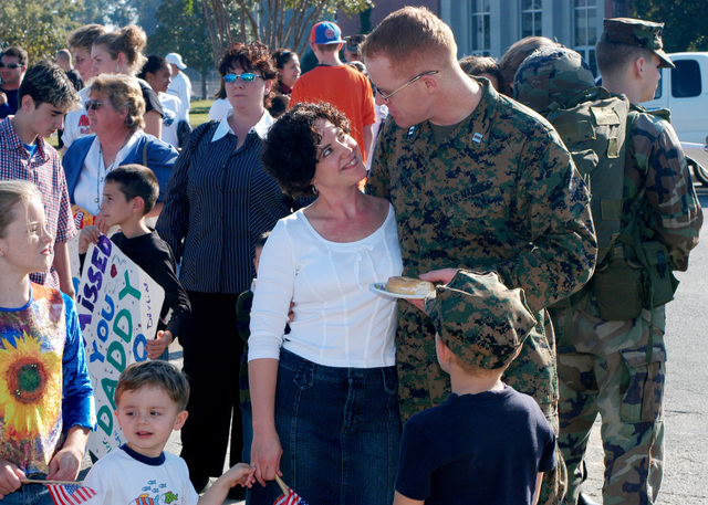 US Marine Corps (USMC) Captain (CAPT) James Jarvis, Public Affairs Officer (PAO), 26th Marine Expeditionary Unit (MEU), greets his family at the MEU's homecoming. The 26th MEU is home after an eight-month deployment including operations in Iraq and Liberia