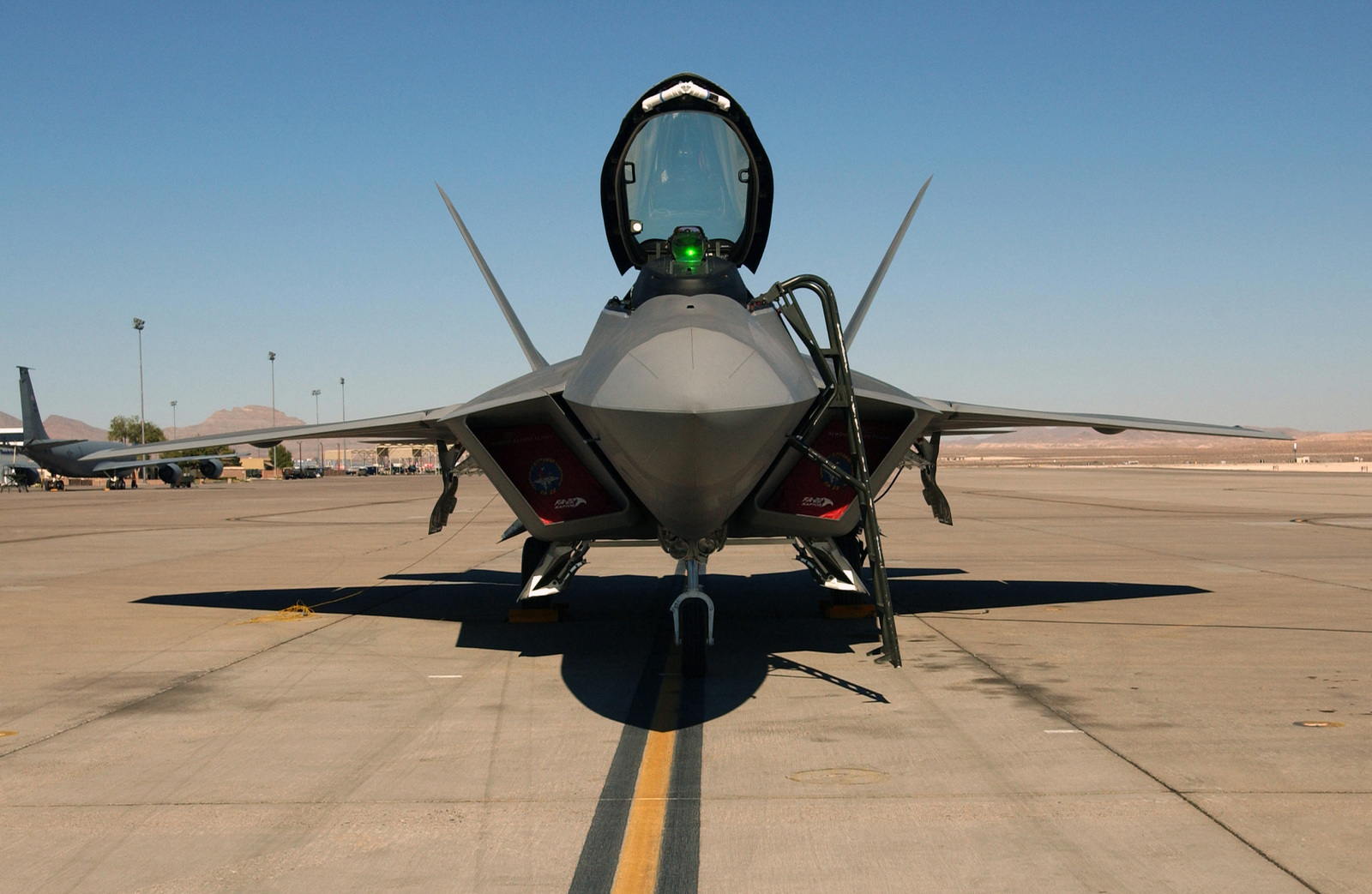 A US Air Force (USAF) Lockheed Martin built F/A-22 Raptor fighter sits on the parking ramp at Nellis Air Force Base (AFB), Nevada (NV)