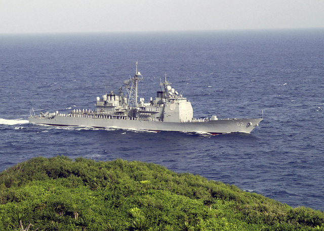 Starboard side view of the US Navy (USN) TICONDEROGA CLASS: GUIDED MISSILE CRUISER (AGEIS), USS CHANCELLORSVILLE (CG 62), underway way off the coast of Santa Rita, Guam