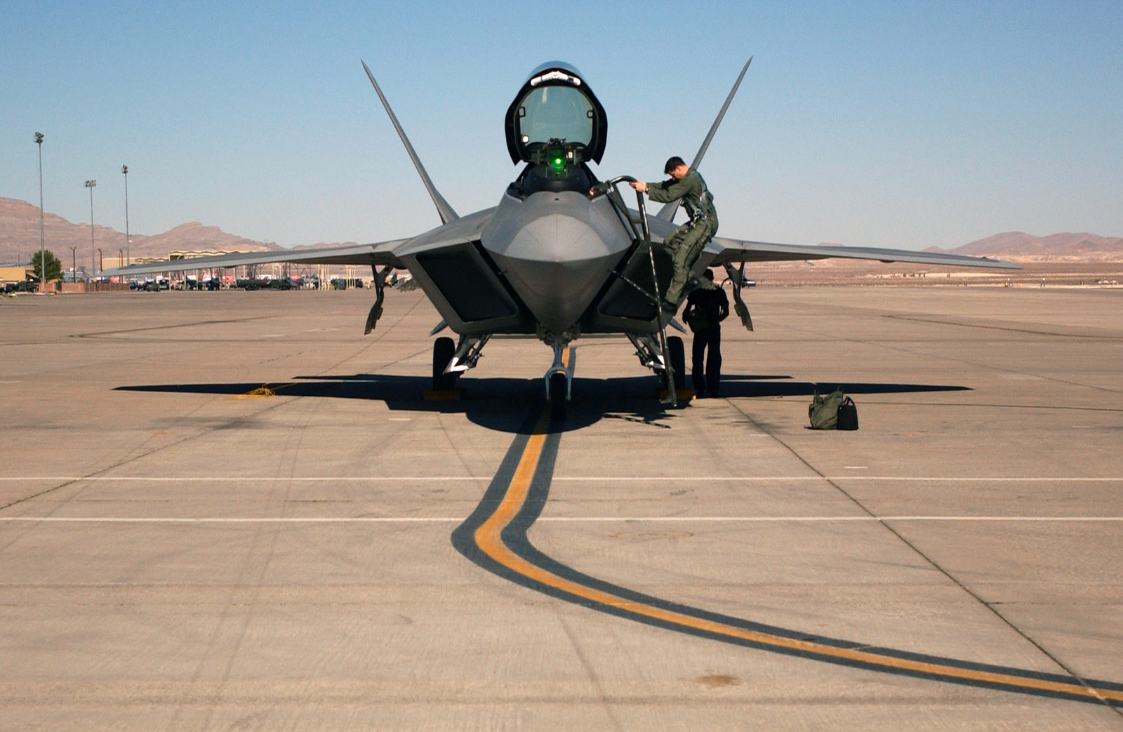 US Air Force (USAF) Major (MAJ) Mike Hernandez climbs out of his Lockheed Martin built F/A-22 Raptor fighter after flying a training mission at Nellis Air Force Base (AFB), Nevada (NV)