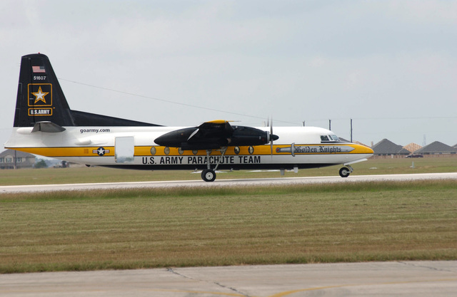 A US Army (USA) C-31 Fokker aircraft, painted with the emblem and paint scheme for the Golden Knights Parachute Team, taxies for take off, during the annual Military Air Show, on the flight line at Randolph Air Force Base (AFB), Texas (TX)