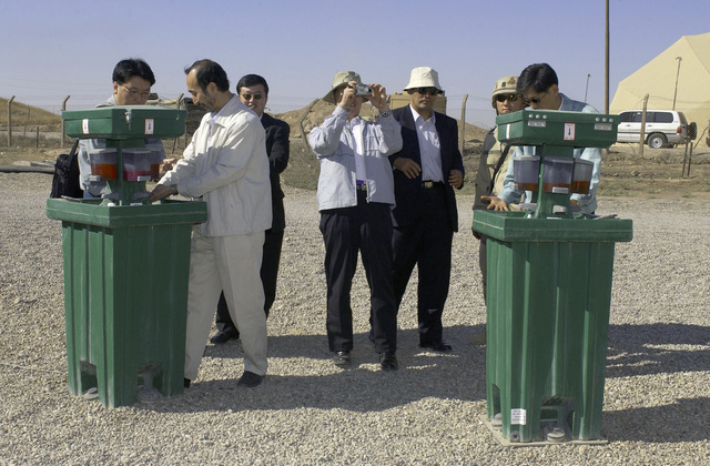 Republic of Korea (ROK) National Security delegates use the portable hand washing units outside of the US Air Force (USAF) dining facility at Kirkuk Air Base (AB), Iraq, during Operation IRAQI FREEDOM. The ROK Security Advisors visited Kirkuk as part of an operational overview tour
