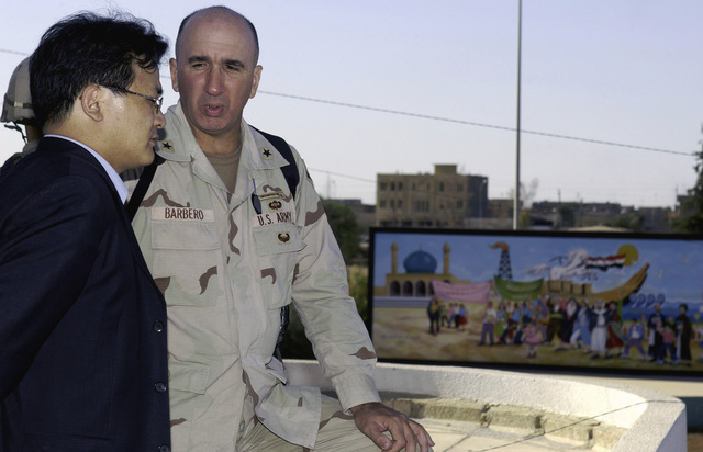 Republic of Korea (ROK) National Security Strategy and Planning Officer, Sung-Bae Kim, speaks with US Army (USA) Brigadier General (BGEN) Michael D. Barbero, Assistant Division Commander (Maneuver), 4th Infantry Division (ID), at Kirkuk Iraq, during Operation IRAQI FREEDOM. The ROK Security Advisors visited Kirkuk as part of an operational overview tour