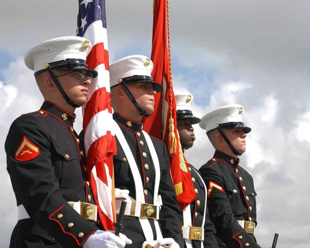 The Color Guard from Headquarters and Service (H&S) Battalion, Marine Corps Recruit Depot (MCRD) Parris Island, South Carolina (SC), stand at parade during MCRD Parris Island's Birthday Pageant. In the Pageant, Marines dress in traditional uniforms and give a speech about the particular era they represent