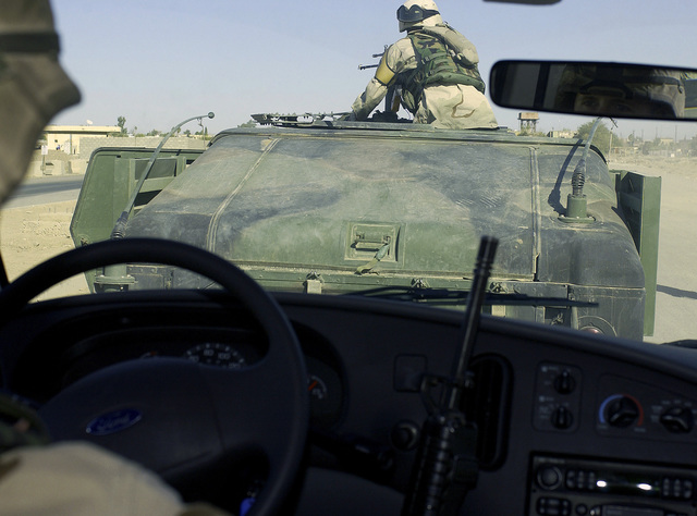 US Army (USA) Soldiers, 2nd Battalion (BN), 503rd Infantry Regiment (2/503), 173rd Airborne (ABN) Brigade, transport Republic of Korea (ROK) National Security delegates in a convoy from Kirkuk Air Base (AB), At Ta Mim Province, Iraq, after they visited Kirkuk AB as part of an operational overview tour during Operation IRAQI FREEDOM