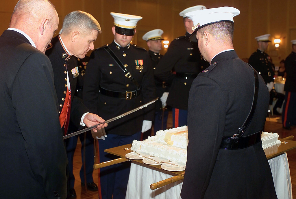 US Marine Corps (USMC) Lieutenant General (LGEN) Edward Hanlon, Jr., Commanding General, Marine Corps Combat Development Command (MCCDC), host of the ball for the 228th Birthday of the United States Marine Corps prepares to cut the birthday cake at The Hilton located in Alexandria, Virginia. In keeping with tradition, the first piece of cake is given to the oldest Marine present and the second to the youngest Marine present