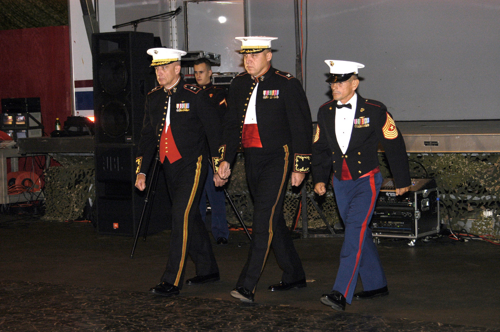 US Marine Corps (USMC) Major General (MGEN) John G. Castlellwa, left, Colonel (COL) Link P. Ermis, center and Sergeant Major (SGM) Sanchez, march in step during the Group-27 US Marine Corps (USMC) Birthday Ball, at Cherry Point, North Carolina