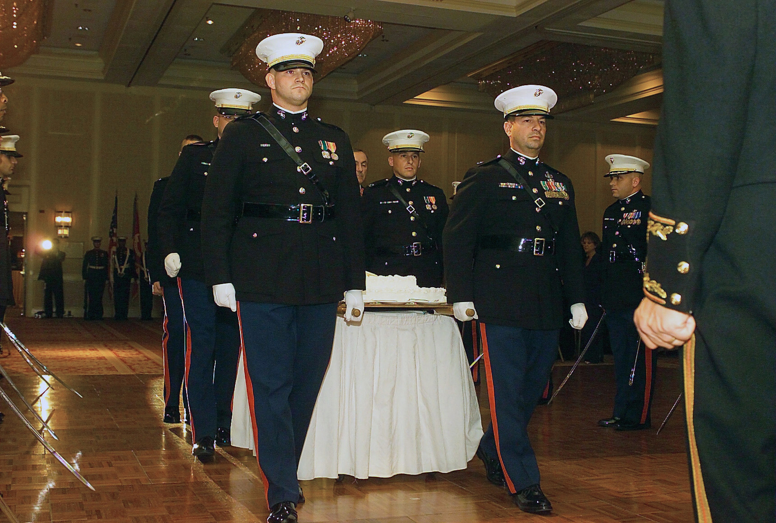 US Marine Corps (USMC) Officers of Marine Corps Combat Development Command (MCCDC) transport the cake for the 228th Birthday of the United States Marine Corps through an honor gauntlet at the Hilton in Alexandria, Virginia (VA)