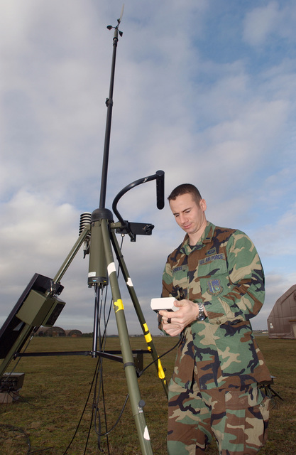 US Air Force (USAF) First Lieutenant (1LT) Damon Vorhees, Wing Weather Officer, 48th Operation Support Squadron (OSS), Royal Air Force (RAF) Lakenheath, United Kingdom, performs an operation check on the AN/TMQ-53 Tactical Meteorological Observing System (TMOS) sensor. The TMOS can measure multiple weather parameters at once to include temperature, dew point, lightning strikes, cloud heights, pressure, present weather, and visibility. This is one of many pieces of equipment that assist in providing direct force-enhancement support to the wing