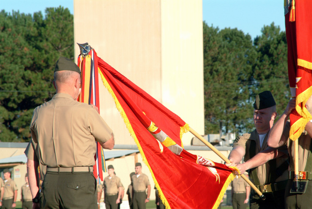 At Marine Corps Air Station (MCAS) Beaufort, South Carolina, US Marine Corps (USMC) Major General (MGEN) John T. Castellaw, Commanding General (CG), Second Marine Air Wing (MAW), pins the Presidential Unit Citation streamer on the Squadron Colors for the units from Marine Aircraft Group 31 (MAG-31), a participant in Operation IRAQI FREEDOM